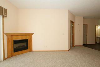 Photo 12: 213 72 QUIGLEY Drive: Cochrane Apartment for sale : MLS®# C4184046