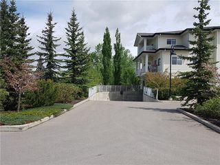 Photo 3: 213 72 QUIGLEY Drive: Cochrane Apartment for sale : MLS®# C4184046