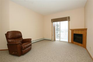 Photo 10: 213 72 QUIGLEY Drive: Cochrane Apartment for sale : MLS®# C4184046