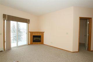 Photo 11: 213 72 QUIGLEY Drive: Cochrane Apartment for sale : MLS®# C4184046