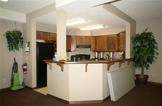Photo 24: 213 72 QUIGLEY Drive: Cochrane Apartment for sale : MLS®# C4184046
