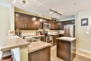 """Photo 5: 234 10838 CITY Parkway in Surrey: Whalley Condo for sale in """"The Access"""" (North Surrey)  : MLS®# R2281970"""