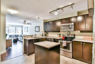 """Photo 2: 234 10838 CITY Parkway in Surrey: Whalley Condo for sale in """"The Access"""" (North Surrey)  : MLS®# R2281970"""