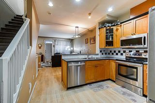 Photo 8: 14 7250 144 Street in Surrey: East Newton Townhouse for sale : MLS®# R2335077