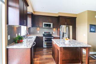 "Photo 3: #129 1460 SOUTHVIEW Street in Coquitlam: Burke Mountain Townhouse for sale in ""Cedar Creek"" : MLS®# R2489857"