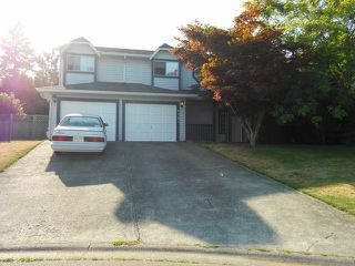Photo 1: 6051 172B Street in Surrey: Cloverdale BC House for sale (Cloverdale)  : MLS®# F1426653