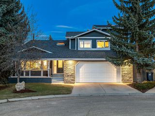 Photo 1: 16 COACH GATE Court SW in Calgary: Coach Hill House for sale : MLS®# C4184031