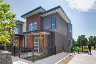 Main Photo: 2105 95 BURMA STAR Road SW in Calgary: Currie Barracks Row/Townhouse for sale : MLS®# A1017173