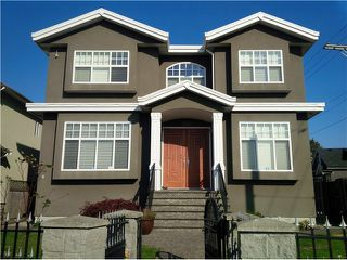 Photo 1: 1591 E 59TH Avenue in Vancouver: Fraserview VE House for sale (Vancouver East)  : MLS®# V1031963