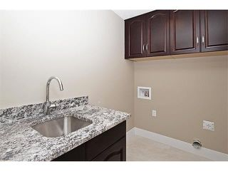 Photo 26: 140 KINNIBURGH Gardens: Chestermere House for sale : MLS®# C4028332