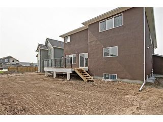 Photo 34: 140 KINNIBURGH Gardens: Chestermere House for sale : MLS®# C4028332