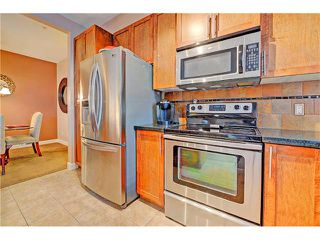 Photo 11: 105 88 ARBOUR LAKE Road NW in Calgary: Arbour Lake Condo for sale : MLS®# C4094540