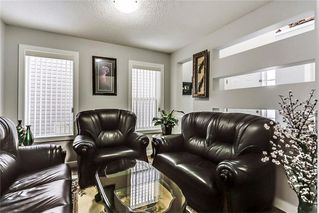 Photo 8: 325 Saddlecrest Way NE in Calgary: Saddle Ridge House  : MLS®# C4149874