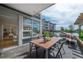 "Photo 3: 102 4500 WESTWATER Drive in Richmond: Steveston South Condo for sale in ""COPPER SKY WEST"" : MLS®# R2266032"