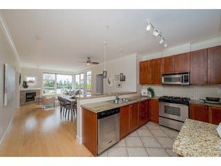 "Photo 4: 102 4500 WESTWATER Drive in Richmond: Steveston South Condo for sale in ""COPPER SKY WEST"" : MLS®# R2266032"