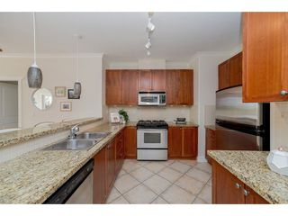 "Photo 6: 102 4500 WESTWATER Drive in Richmond: Steveston South Condo for sale in ""COPPER SKY WEST"" : MLS®# R2266032"