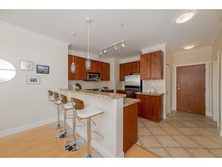 "Photo 5: 102 4500 WESTWATER Drive in Richmond: Steveston South Condo for sale in ""COPPER SKY WEST"" : MLS®# R2266032"