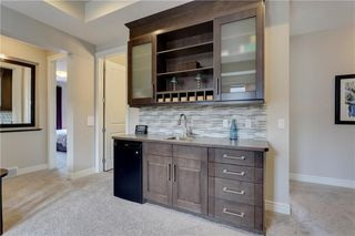 Photo 26: 291 TREMBLANT Way SW in Calgary: Springbank Hill Detached for sale : MLS®# C4199426