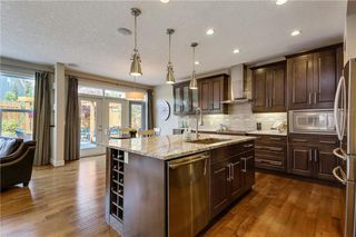 Photo 6: 291 TREMBLANT Way SW in Calgary: Springbank Hill Detached for sale : MLS®# C4199426