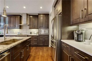 Photo 8: 291 TREMBLANT Way SW in Calgary: Springbank Hill Detached for sale : MLS®# C4199426