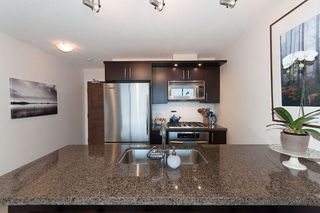 "Photo 11: 704 1650 W 7TH Avenue in Vancouver: Fairview VW Condo for sale in ""VIRTU"" (Vancouver West)  : MLS®# R2015471"