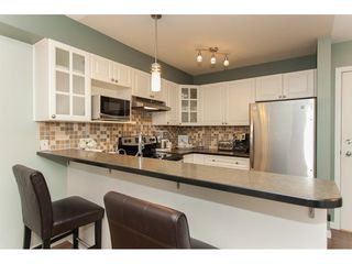 "Photo 7: 305 20896 57 Avenue in Langley: Langley City Condo for sale in ""BAYBERRY LANE"" : MLS®# R2214120"