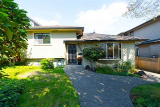Photo 1: 7688 BURGESS Street in Burnaby: Edmonds BE House for sale (Burnaby East)  : MLS®# R2308571