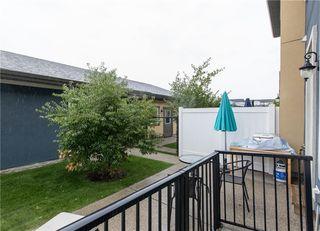Photo 3: 460 QUARRY PARK Boulevard SE in Calgary: Douglasdale/Glen Row/Townhouse for sale : MLS®# C4236321