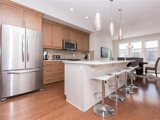 Photo 7: 460 QUARRY PARK Boulevard SE in Calgary: Douglasdale/Glen Row/Townhouse for sale : MLS®# C4236321