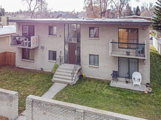 Photo 2: 120 29 Avenue NW in Calgary: Tuxedo Park Multi Family for sale : MLS®# A1045852