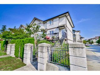 "Photo 2: 1 14855 100 Avenue in Surrey: Guildford Townhouse for sale in ""HAMSTEAD MEWS"" (North Surrey)  : MLS®# F1449061"