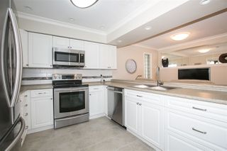 """Photo 4: 101 219 BEGIN Street in Coquitlam: Maillardville Townhouse for sale in """"PLACE FOUNTAINEBLEU"""" : MLS®# R2090733"""