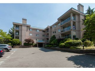 """Photo 1: 109 33110 GEORGE FERGUSON Way in Abbotsford: Central Abbotsford Condo for sale in """"Tiffany Park"""" : MLS®# R2189830"""