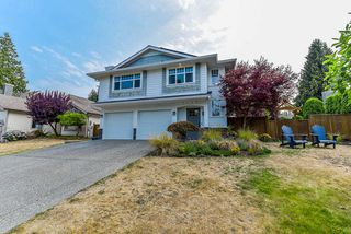 Photo 1: 2438 127B Street in Surrey: Crescent Bch Ocean Pk. House for sale (South Surrey White Rock)  : MLS®# R2310859