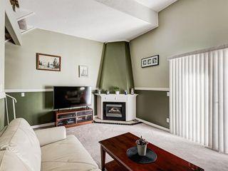 Photo 2: 1101 919 38 Street NE in Calgary: Marlborough Row/Townhouse for sale : MLS®# A1031819