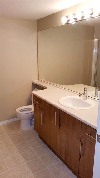 "Photo 12: 207 700 KLAHANIE Drive in Port Moody: Port Moody Centre Condo for sale in ""Boarwalk"" : MLS®# R2021637"