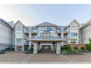 "Photo 1: 205 3122 ST JOHNS Street in Port Moody: Port Moody Centre Condo for sale in ""SONRISA"" : MLS®# R2273265"