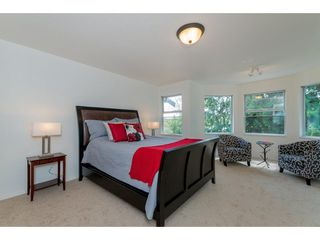"Photo 11: 210 13900 HYLAND Road in Surrey: East Newton Townhouse for sale in ""Hyland Grove"" : MLS®# R2295690"