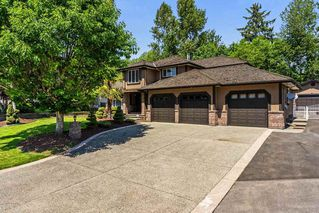 "Main Photo: 14463 80 Avenue in Surrey: Bear Creek Green Timbers House for sale in ""British Manor"" : MLS®# R2320512"