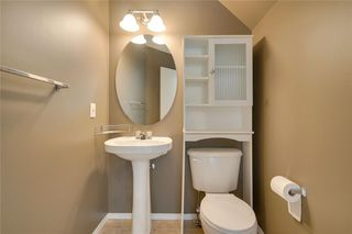 Photo 18: 157 TUSCANY SPRINGS Garden NW in Calgary: Tuscany Row/Townhouse for sale : MLS®# C4303532