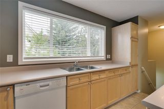 Photo 6: 157 TUSCANY SPRINGS Garden NW in Calgary: Tuscany Row/Townhouse for sale : MLS®# C4303532