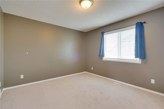 Photo 13: 157 TUSCANY SPRINGS Garden NW in Calgary: Tuscany Row/Townhouse for sale : MLS®# C4303532