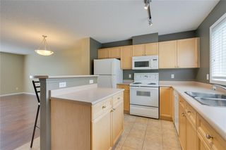 Photo 3: 157 TUSCANY SPRINGS Garden NW in Calgary: Tuscany Row/Townhouse for sale : MLS®# C4303532