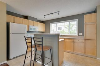 Photo 5: 157 TUSCANY SPRINGS Garden NW in Calgary: Tuscany Row/Townhouse for sale : MLS®# C4303532