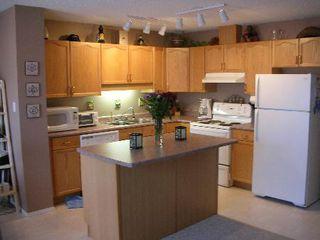 Photo 2: 16221 - 93 Street: Condo for sale (Eaux Claires)