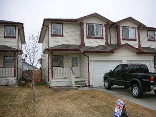 Photo 1: 16221 - 93 Street: Condo for sale (Eaux Claires)