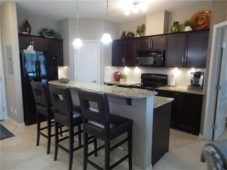 Photo 3: 311 1 CRYSTAL GREEN Lane: Okotoks Condo for sale : MLS®# C4090546