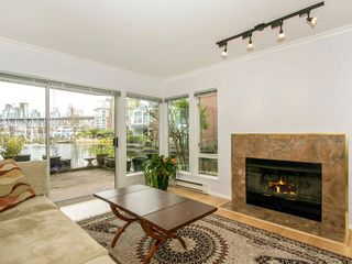 "Photo 7: 1585 MARINER Walk in Vancouver: False Creek Townhouse for sale in ""LAGOONS"" (Vancouver West)  : MLS®# R2158122"