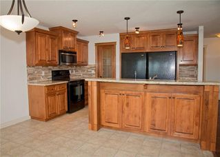 Photo 15: 232 CIMARRON Drive: Okotoks House for sale : MLS®# C4116292