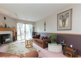 "Photo 4: 214 34909 OLD YALE Road in Abbotsford: Abbotsford East Townhouse for sale in ""The Gardens~"" : MLS®# R2254662"
